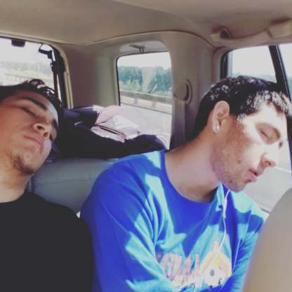Fabian Panduro and Gabe Acosta sleep during the ride down to Salem.